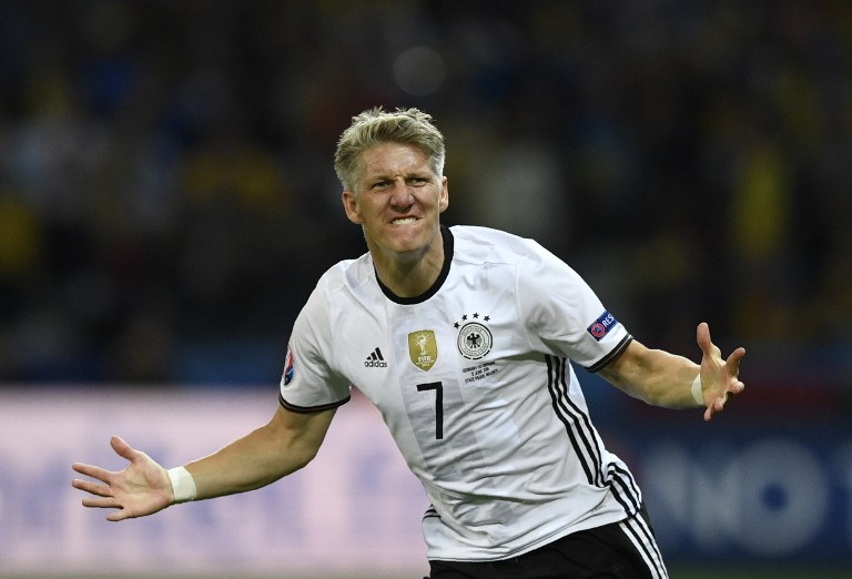 Germany's midfielder Bastian Schweinsteiger celebrates after scoring a goal during the Euro 2016 group C football match between Germany and Ukraine at the Stade Pierre Mauroy in Villeneuve-d'Ascq near Lille on June 12, 2016. / AFP PHOTO / MARTIN BUREAU