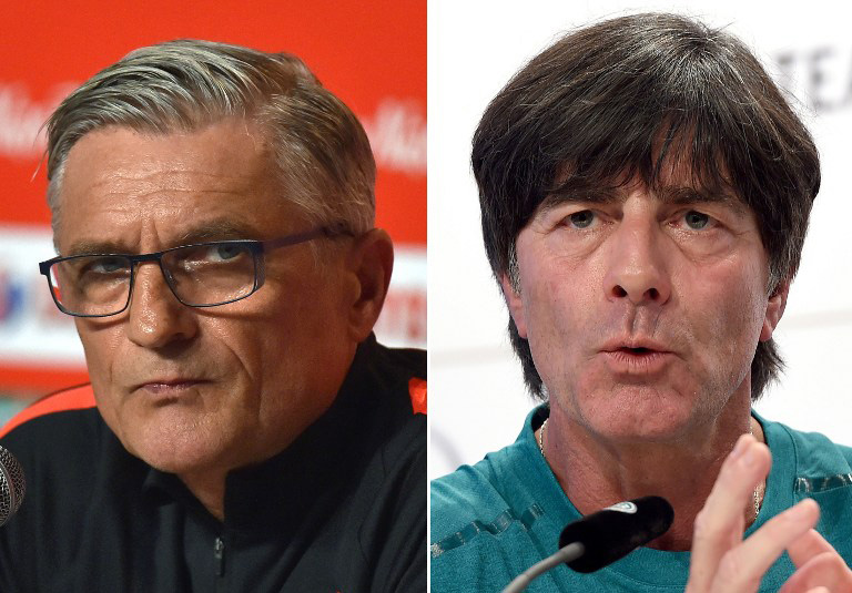 Polens Trainer Adam Nawalka und der deutsche Bundestrainer Joachim Löw - am 16.Juni trifft man sich im Vorrundenspiel in Paris. / AFP PHOTO / LOIC VENANCE AND Patrik STOLLARZ